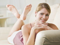 Woman Lying on Couch Royalty Free Stock Images