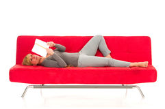 Woman lying on the couch Royalty Free Stock Image
