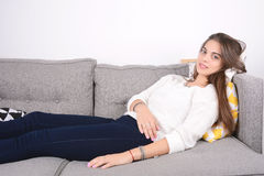 Woman lying on couch. Royalty Free Stock Photo