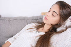 Woman lying on couch. Royalty Free Stock Photos