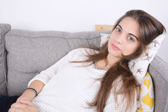 Woman lying on couch. Stock Images