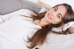 Woman lying on couch. Royalty Free Stock Photography
