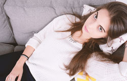 Woman lying on couch. Royalty Free Stock Images