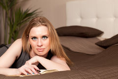 Woman lying on the couch Stock Photography