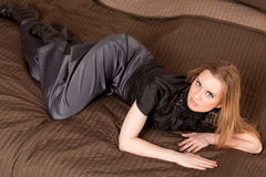 Woman lying on the couch Stock Photo