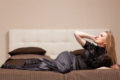 Woman lying on the couch Royalty Free Stock Images