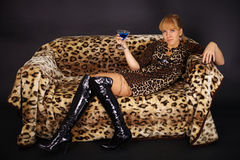 Woman lying on couch - Leopard theme Royalty Free Stock Photo