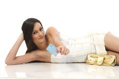 Woman lying with credit card. Woman  lying on floor with credit card Stock Photography