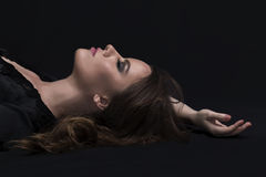 Woman lying in the dark Stock Photo