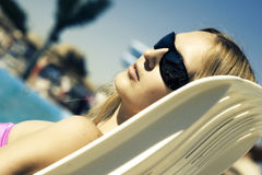 Woman lying on a deckchair Royalty Free Stock Images