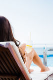 Woman lying on deckchair with cocktail Royalty Free Stock Photo