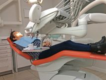 Woman lying in the dental clinic Stock Photography
