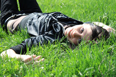 Woman lying down Royalty Free Stock Images