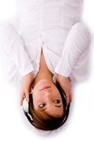 Woman Lying Down And Enjoying Music Stock Images