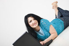 Woman Lying Down And Using Laptop Stock Image