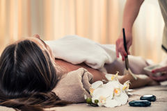 Woman lying down during Asian anti-aging treatment Royalty Free Stock Photo