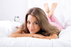 Woman lying down on bed. Bedtime collection: woman lying down on bed Stock Photography
