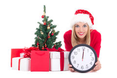Woman lying down with clock, christmas tree and gifts isolated o Stock Images