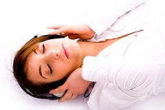 Woman lying down on floor tuned to music Stock Image