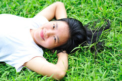 Woman lying down on grass Stock Photos