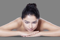 Woman lying down on hands after skincare Stock Photos