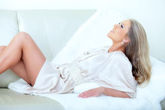 Woman lying down on her bed Royalty Free Stock Image