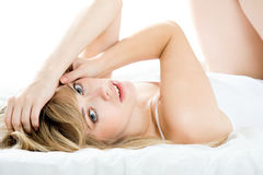 Woman lying down on her bed at home Royalty Free Stock Image