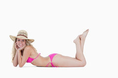 Woman lying down with her legs crossed Stock Photography