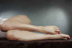 Woman lying down legs and feet Royalty Free Stock Photography