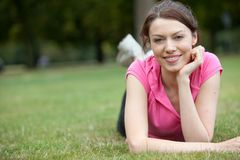 Woman lying down outdoors Royalty Free Stock Photo