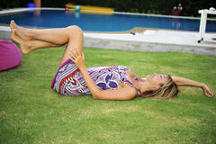 Woman lying down by pool Stock Photos