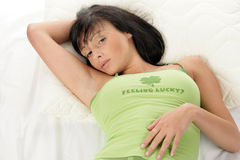 Woman lying down resting Stock Photos