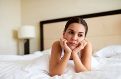 Woman lying down resting chin in hands. Royalty Free Stock Photo