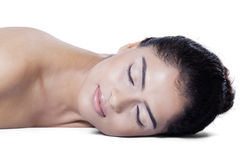Woman lying down after skincare Stock Photography