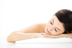 Woman  lying down on towel during skin care Stock Photos