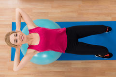 Woman Lying On Exercise Ball Royalty Free Stock Images