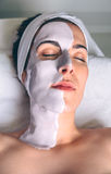 Woman lying with facial mask treatment in spa Stock Photography