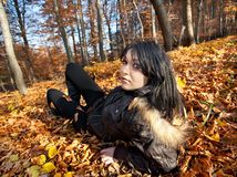 Woman lying in fallen leaves Royalty Free Stock Image