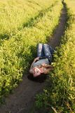 Woman lying in field Stock Photo