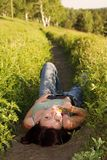 Woman lying in field Royalty Free Stock Photos