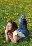 Woman lying in field of flowers Royalty Free Stock Photography
