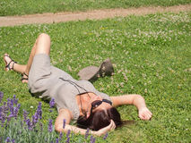 Woman lying. Fine woman lying on the green grass Royalty Free Stock Images