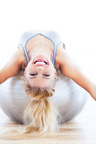Woman lying on fitness ball Stock Image