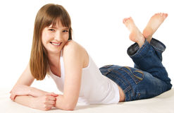 Woman lying on floor. Young woman lying on floor stock photography
