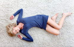 Woman lying on the floor Stock Images