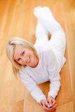 Woman lying on the floor Royalty Free Stock Photo