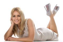 Woman lying on floor Stock Image