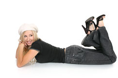 Woman lying on floor. Relaxed woman wearing jeans and t-shirt lying on the floor royalty free stock photography