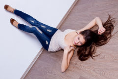 Woman lying on the floor Royalty Free Stock Photography