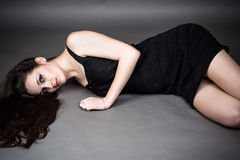 Woman lying on the floor Stock Photography